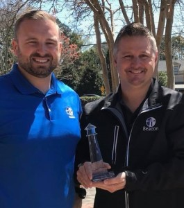 David Dees (Beacon, left) presents Jason Carver (Owner, Total Pro Roofing, right) with the 2018 Lighthouse Award